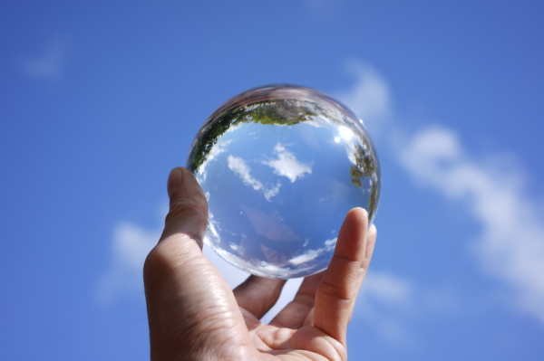 Crystal ball image of a blue sky