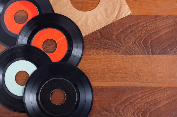 Record vinyl top view in wooden background